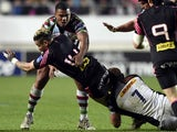 Caption:Paris' Fidjian winger Waisea Nayacalevu Vuidravuwalu vies with Harlequin's captain Chris Robshaw during the Amlin Challenge Cup rugby union match between Stade Francais and Harlequins at the Jean Bouin stadium on April 4, 2014