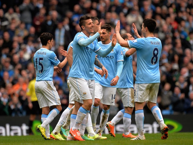 Stevan Jovetic of Manchester City is congratulated by teammate Sami Nasri after scoring his team's fourth goal during the Barclays Premier League match against Southampton on April 5, 2014