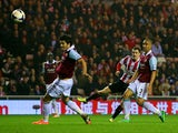 Adam Johnson of Sunderland scores a goal to bring his team back into contention at 2-1 during the Barclays Premier League match between Sunderland and West Ham United at the Stadium of Light on March 31, 2014