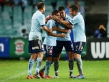 Ali Abbas of Sydney FC celebrates with team mates after scoring a goal during the round 26 A-League match between Sydney FC and the Wellington Phoenix at Allianz Stadium on April 6, 2014