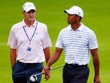Tiger Woods (R) chats with his swing coach Hank Haney during a practice round prior to the start of the 91st PGA Championship at the Hazeltine Golf Club on August 10, 2009