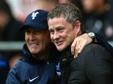 Tony Pulis the Crystal Palace manager and Ole Gunnar Solskjaer the Cardiff manager greet each other prior to kickoff during the Barclays Premier League match between their sides on April 5, 2014