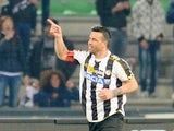 Antonio Di Natale of Udinese Calcio celebrates after scoring his opening goal during the Serie A match between Udinese Calcio and Calcio Catania at Stadio Friuli on March 31, 2014