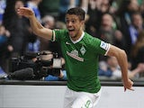 Caption:Bremen's Argentinian forward Franco Di Santo celebrates scoring during the German first division Bundesliga football match SV Werder Bremen vs FC Schalke 04 on April 5, 2014