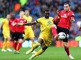 Yannick Bolasie of Crystal Palace and Jordon Mutch of Cardiff compete for the ball during the Barclays Premier League match on April 5, 2014