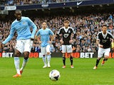 Yaya Toure of Manchester City scores the opening goal from the penalty spot during the Barclays Premier League match against Southampton on April 5, 2014