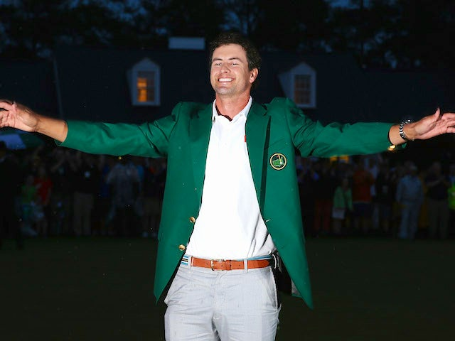 Adam Scott smiles after receiving his green jacket for winning The Masters at Augusta National on April 14, 2013