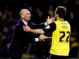 Almen Abdi of Watford celebrates with his manager Beppe Sannino after opening the scoring during the Sky Bet Championship match between Watford and Leeds United at Vicarage Road on April 8, 2014