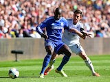 Swansea's Angel Rangel and Chelsea's Demba Ba in actionduring the Premier League match on April 13, 2014