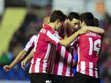 Athletic Bilbao's forward Aritz Aduriz celebrates with his teammates after scoring during the Spanish league football match Levante UD vs Athletic Club Bilbao at the Ciutat de Valencia stadium in Valencia on April 7, 2014