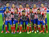 Atletico de Madrid players pose for a team photo before kick-off in the Champions League quarter final match against Barcelona on April 9, 2014