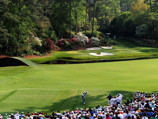 Tiger Woods hits his tee shot on the 12th hole during the second round of the 2011 Masters Tournament at Augusta National Golf Club on April 8, 2011