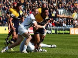 Augustin Creevy of Worcester Warriors passes out of the tackle by Matt Jess of Exeter Chiefs during the Aviva Premiership match on April 12, 2014