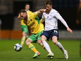 Ben Davies of Sheffield United holds off a challenge from Joe Garner of Preston North End during the Sky Bet League One match between Preston North End and Sheffield United at Deepdale on March 17, 2014