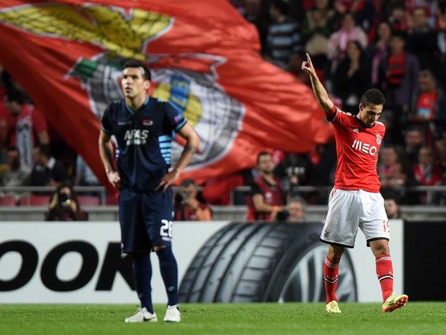 Benfica's Spanish forward Rodrigo Machado celebrates after scoring the opening goal during the UEFA Europa League quarterfinal second leg football match SL Benfica vs AZ Alkmaar at the Luz stadium in Lisbon on April 10, 2014