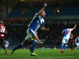 Tommy Spurr of Blackburn Rovers celebrates after scoring the second goal during the Sky Bet Championship match between Blackburn Rovers and Queens Park Rangers at Ewood Park on April 08, 2014