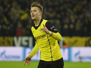 Dortmund's striker Marco Reus celebrates scoring during the UEFA Champions League quarter-final, second leg football match Borussia Dortmund vs Real Madrid CF on April 8, 2014