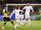 Dortmund's Serbian midfielder Milos Jojic and Real Madrid's Croatian midfielder Luka Modric and Real Madrid's French forward Karim Benzema vie for the ball during the UEFA Champions League quarter-final, second leg football match Borussia Dortmund vs Real