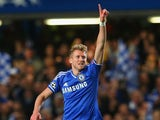 Andre Schurrle of Chelsea celebrates scoring their first goal during the UEFA Champions League Quarter Final second leg match between Chelsea and Paris Saint-Germain FC at Stamford Bridge on April 8, 2014