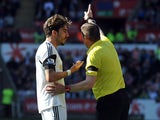 Swansea's Chico Flores is sent off by referee Phil Dowd against Chelsea during the first half of the Premier League match on April 13, 2014
