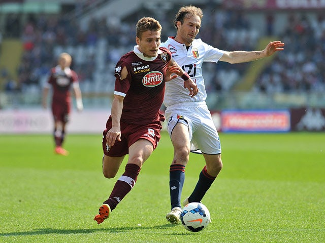 Torino's Ciro Immobile and Genoa's Giovanni Marchese in action during the Serie A match on April 13, 2014