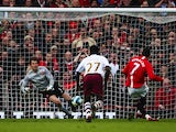 Manchester United's Cristiano Ronaldo scores the opening goal via the penalty spot against Arsenal during the Premier League match on April 13, 2008