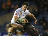 Caption:Perpignan's Samoan flanker Dan Leo is tackled by Roddy Grant during the European Cup rugby union match between Edinburgh and Perpignan at Murrayfield Stadium in Edinburgh on January 11, 2014