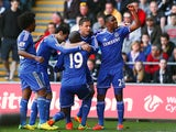 Chelsea's Demba Ba is congratulated by team mates after scoring the opening goal against Swansea during the Premier League match on April 13, 2014