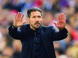 Atletico Madrid head coach Diego Simeone gestures during the Champions League quarter final match against Barcelona on April 9, 2014