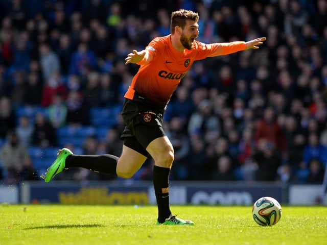 Nadir Ciftci of Dundee United celebrates scoring during the William Hill Scottish Cup Semi Final between Rangers and Dundee United at Ibrox Stadium on April 12, 2014