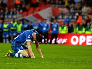 Wigan Athletic captain Gary Caldwell slumps to the ground after missing the first penalty of the FA Cup semi-final shootout against Arsenal at Wembley on April 12, 2014
