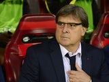 Barcelona head coach Gerardo 'Tata' Martino looks on during the Champions League quarter final match against Atletico Madrid on April 9, 2014