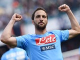 Napoli's Gonzalo Higuain celebrates after scoring his team's second goal against Lazio during the Serie A match on April 13, 2014