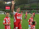 Harry Kewell of Melbourne Heart waves to the crowd with his children after playing his final match and retiring from football after their round 27 A-League match on April 12, 2014