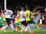 Fulham's Colombian forward Hugo Rodallega (Foreground-L) shoots to score a goal during the English Premier League football match against Norwich City on April 12, 2014
