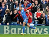 Jason Puncheon of Crystal Palace celebrates as he scores their first goal during the Barclays Premier League match on April 12, 2014