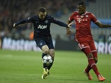 Bayern Munich's Jerome Boateng and Manchester United's Wayne Rooney in action during their Champions League quarter final match on April 9, 2014