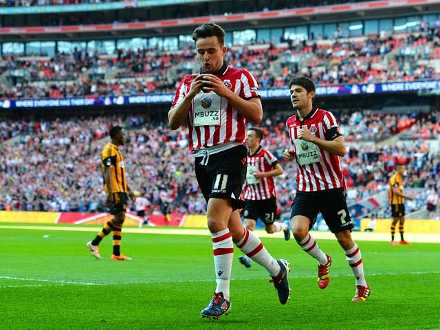 Sheffield United's Jose Baxter celebrates after scoring the opening goal against Hull during their FA Cup semi final match on April 13, 2014
