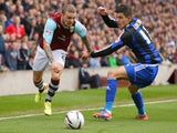 Burnley's Kieran Trippier (L) gets past Middlesbrough's Emanuel Ledesma during the Sky Bet Championship match on April 12, 2014