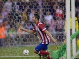 Atletico Madrid's Koke celebrates after scoring the opening goal against Barcelona during their Champions League quarter final match on April 9, 2014