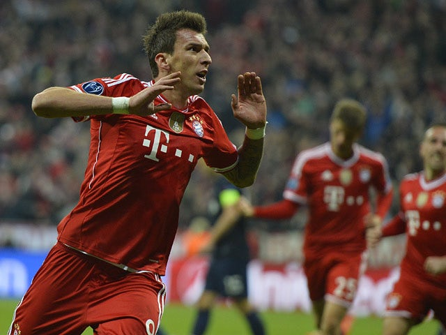 Bayern Munich's Mario Mandzukic celebrates after scoring his team's opening goal against Manchester United in the Champions League quarter final match on April 9, 2014