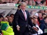 Stoke City's Welsh manager Mark Hughes attends the English Premier League football match between Stoke City and Newcastle United at the Britannia Stadium in Stoke on Trent on April 12, 2014