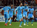 Marseille's French forward Andre-Pierre Gignac celebrateswith teammates after scoring a goal on April 11, 2014