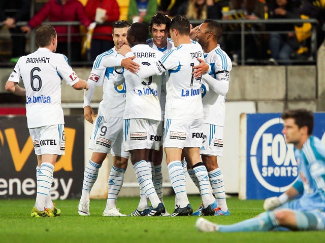 Guilherme Finkler of the Victory is congratulated by teammates after scoring a goal during the round 27 A-League match between Wellington Phoenix and Melbourne Victory at Westpac Stadium on April 12, 2014