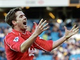 Liverpool's Michael Owen celebrates scoring his team's third goal against Leeds during their Premiership clash at Elland Road in Leeds on 3 February 2002