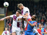 Nathan Baker of Aston Villa out jumps teammate Ciaran Clark and Cameron Jerome of Crystal Palace during the Barclays Premier League match on April 12, 2014
