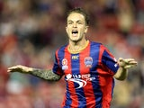 Adam Taggart of the Jets celebrates a goal during the round 27 A-League match between the Newcastle Jets and Adelaide United at Hunter Stadium on April 11, 2014