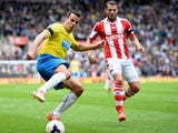 Steven Taylor of Newcastle United battles with Geoff Cameron of Stoke City during the Barclays Premier League match between Stoke City and Newcastle United at Britannia Stadium on April 12, 2014