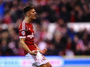 Jamie Paterson of Nottingham Forest celebrates scoring the equalising goal during the Sky Bet Championship match between Nottingham Forest and Sheffield Wednesday at City Ground on April 8, 2014