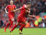 Liverpool's Philippe Coutinho celebrates after scoring his team's third goal against Manchester City during the Premier League match on April 13, 2014
